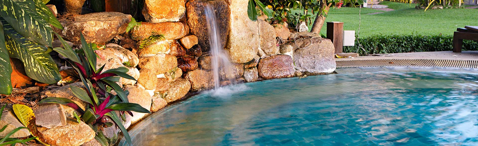outdoor pool patio waterfall